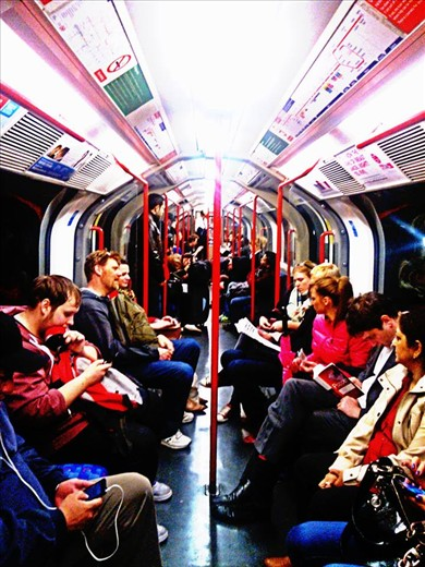 The London Tube - the london tube transports people within the city. The city is a big one. The tube not only blends cultures through the means of people, but also music. If it's not someone taping away to the beats of the song playing through his ear phones, it's the people playing their violins at guitars at the tube stations. Many people think the tube is morbid and mundane. But look closely and observe people...many of them are touritsts, travelers, musicians, business men, students, teachers...a blend of all common professions and passions.