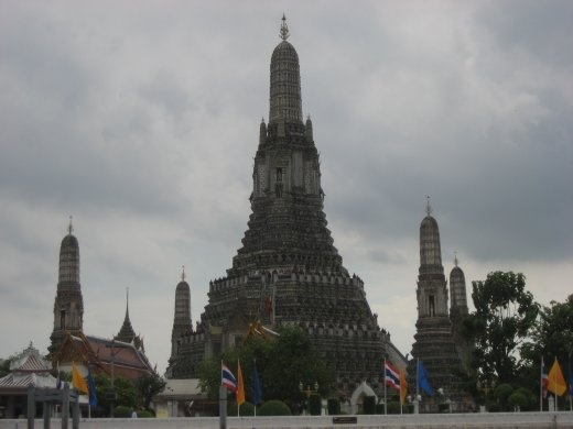 Temple of Dawn (Wat Arun Ratchawararam) seen from on board a boat on the Chao Praya River