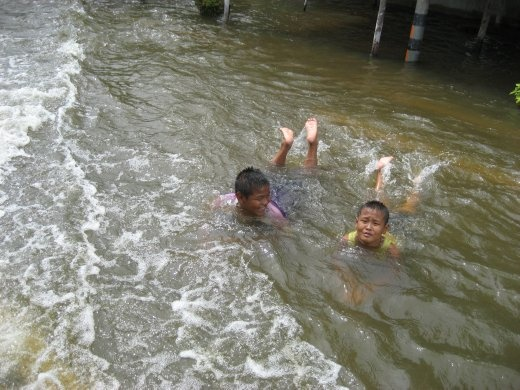 Local boys cooling off in the flood waters