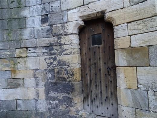 Teeny tiny door in castle ruins