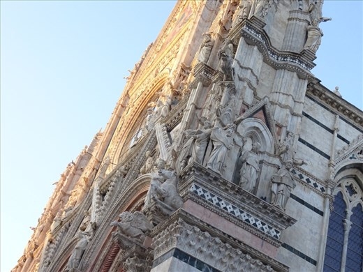Marble carvings on the facade of the Basilica in Siena