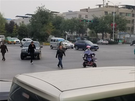 Many people on scooters had these blanket-like things that covered their bodies, heads and hands.