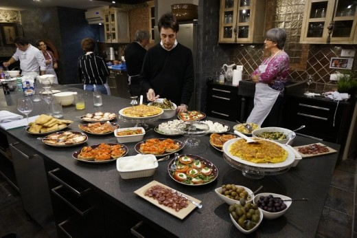 The whole spread, with Gregory making final touches. Isn't the kitchen amazing?