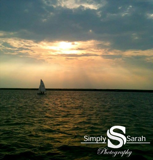 a boat on Lake Erie with a nice sun set