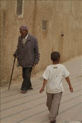 An old and young man going in different directions in Medina.: by szymczykeva, Views[175]