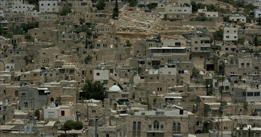 Through a process of rapid settlement expansion, and the very tactical nature in which this is done, Palestinian families are being forced into increasingly smaller spaces for habitation. The West Bank city of Hebron is a perfect example, with many areas of the cities looking more reminiscent of favela's than city dwellings. The hill pictured in this photograph was bombed extensively in the 2000 Intifada.