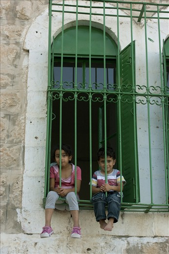 Two children welcomed our group of international visiters to their home in Hebron. Their home had become such a frequent target for Israeli aggression that all of the windows have steel bars to protect the inhabitants, and the children are not allowed to leave their home for more than 10 minutes at a time. Even with these horrendous circumstances for a child to be reared, they still have the curiosity and childishness to wave and smile to new people.