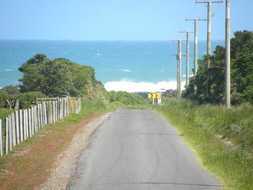 The first straight road in NZ and it looks like it will drop us in the ocean!
