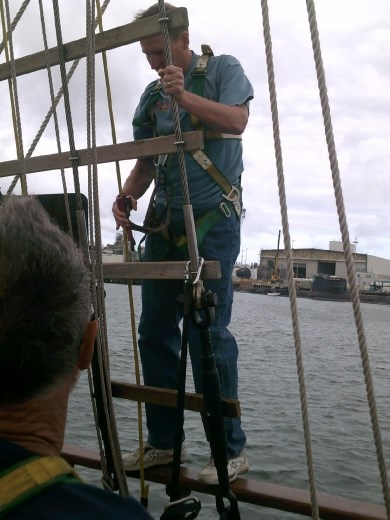 Kent clips his ascender on to the ropes and starts his climb up the mast...