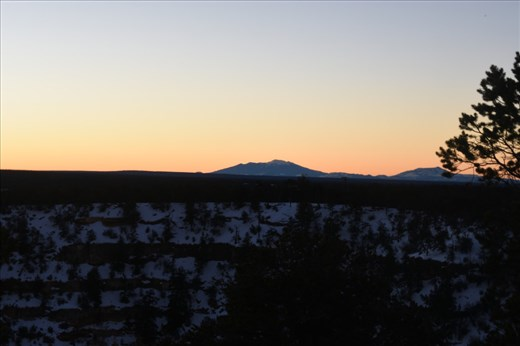 Looking south from the Powell Viewpoint to the San Francisco Peaks bathed in the first light of a new day.