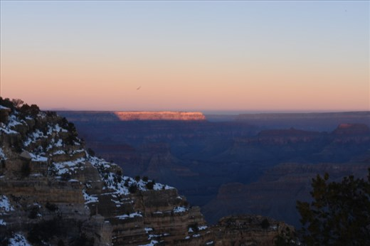 The first rays of sunlight painted the western wall of the Canyon.