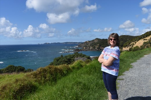 Anna enjoys a sunny stop along the coastal back road to Russell.
