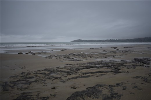 It was a dank and gloomy day when we stopped to the geologically odd Moeraki Boulders.