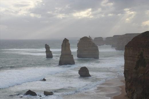 The 12 Apostles loomed eerily as the sun struggled to break through.