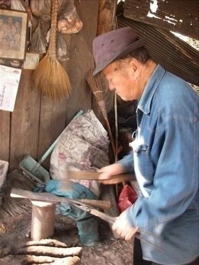 Village elder forging knives