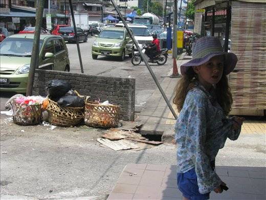 Ni'mah watching out for pavement traps and rubbish - KL