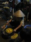 Outside Dalat markets - street food of BBQ rice paper with egg topping - served with sauce and rolled up for easy eating-yum!: by terrihorner, Views[239]