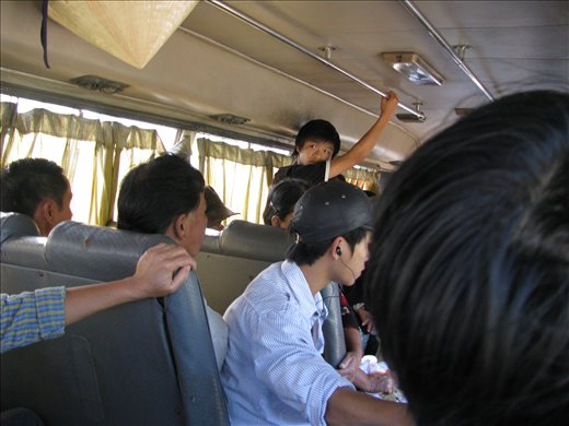 Packing them in on the local minibus: Hoi An-Danang