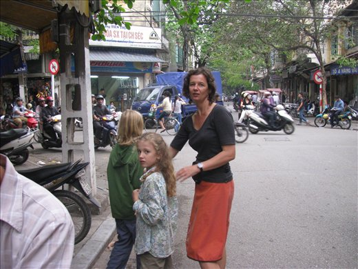 Frantic Mother (me-Terri) keeping daydreaming kids away from traffic- Hanoi