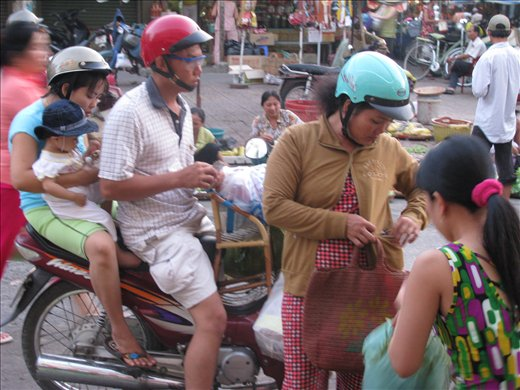 Drive-through purchases at street side vendors, Vinh Long