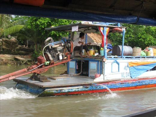 house boat with a car engine mekong river and an binh. Black Bedroom Furniture Sets. Home Design Ideas