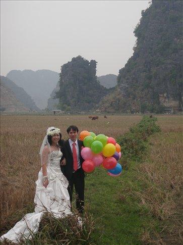 Newlyweds having photos taken at Mua Cave...so cute