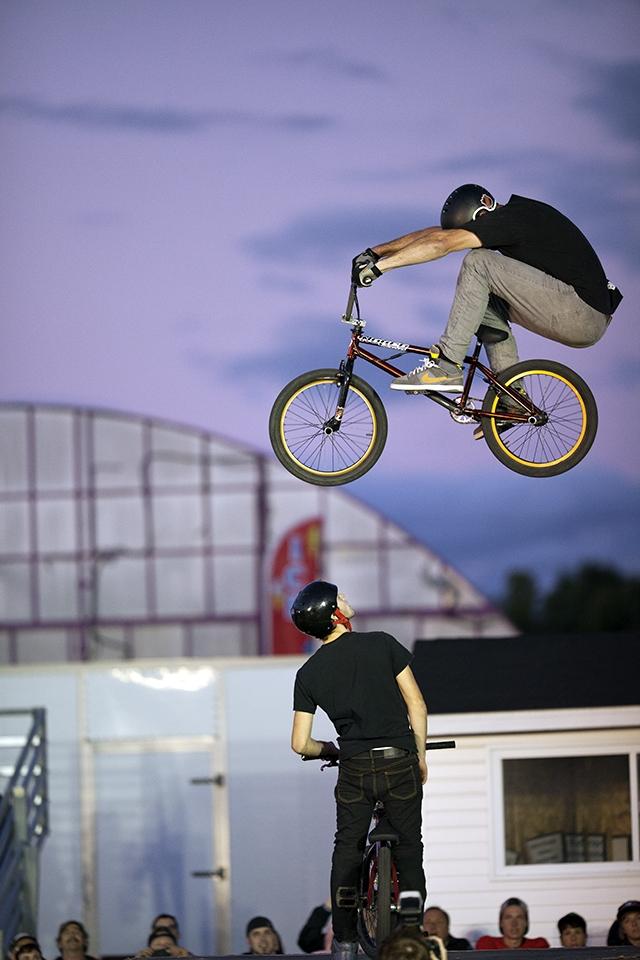 A member of the Craz-E-Crew Stunt Team wows the crowd as he and his bike soar through the air at the 2012 Richmond Fair.