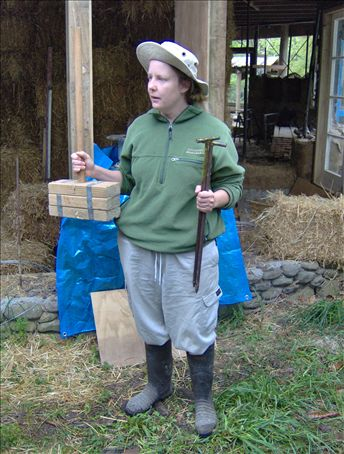 Lou doing her demo on building a strawbale wall.
