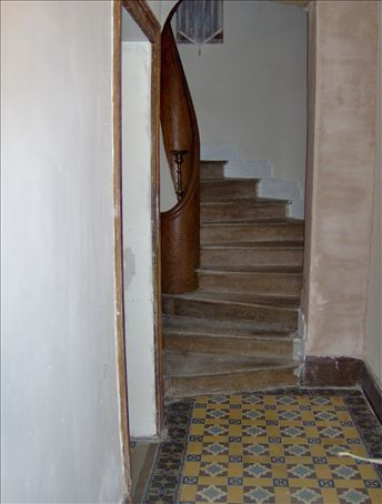 Stairwell in the manor.  It's made of a single Elm tree trunk and it runs up three stories!