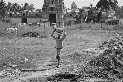 Children living in extreme poverty are a way to make money for the mafia. They are used in illegal operations, sex trafficking and child labour. This image was shot in Tamil Nadu featuring one of such child workers. Every year many children are rescued from child labour but even the resolved cases resort to their previous life because of inadequate rehabilitation and monitoring. It's ironic that this boy is working in the background of a temple yet none of the Gods are watching over him.