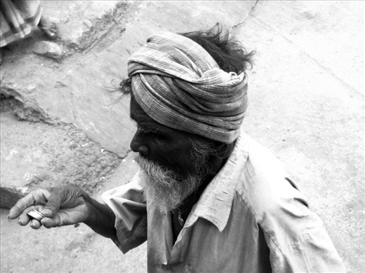 This particular person was counting the coins he earned from someone on the road. They make very little money and live on bare minimum till their death. Most of them don't make 2$ a day and live in extreme poverty without proper food and shelter. This picture reminds me that Poverty can hit you anytime and change a fulfilling life to mere existence.