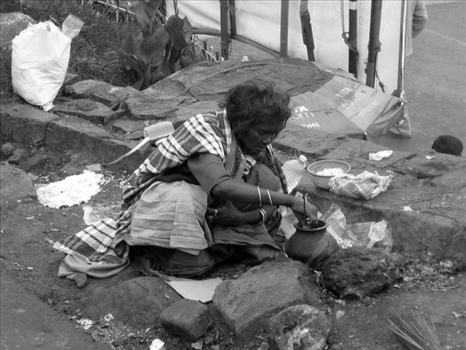 This image portrays an old woman making a meal on the road. She doesn't have a home or someone else to take care of her. Thousands of people living in the streets of India like her share the same living standards and often develop chronic illness. Basic treatments and medication are generally out of their reach and never in time.