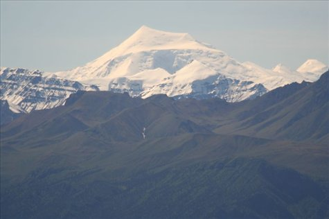 beautiful snowpeaks in the Yukon, we can't tell which one is Mt Logan, Canada's highest peak. Maybe this one?