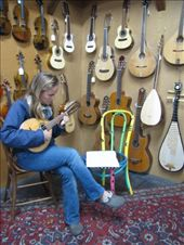 On the way back to Australia we had a layover in LA, where we visited the Folk Music Centre. Anna trying out a 18 stringed mandoline from Bolivia.: by thefuegoproject, Views[403]