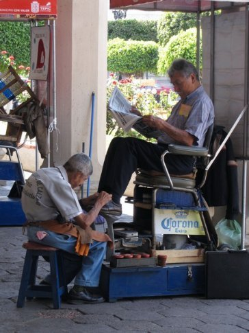 shoe shining is big business in Tepic, while you read the morning news!