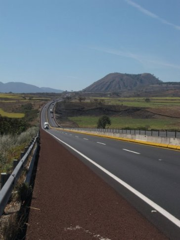 The cuota or tollroad, always up or down, and here with nasty red gravel on the shoulder