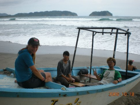 catching up in an old panga on the beach