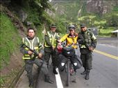 Anna making friends at the roadside checkpoints, second last day in beautiful Colombia. They were nearly always super friendly, but this time they even let us touch their guns!: by thefuegoproject, Views[304]