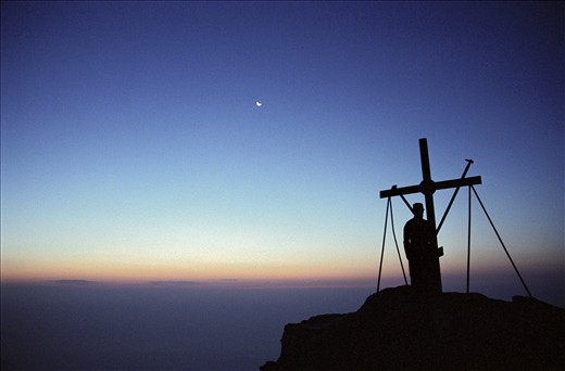 At the sweet sunrising in front of the big cross of the top, meditating to the Lord of the sun and of the whole world,feeling him near your body and soul,in the total silence and peace.