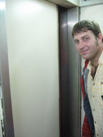 Greg on the tiny elevator