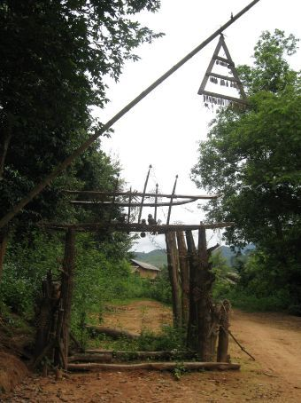 Gate to Akha village...you're not actually supposed to walk through it or even touch it.  Good thing we knew that.