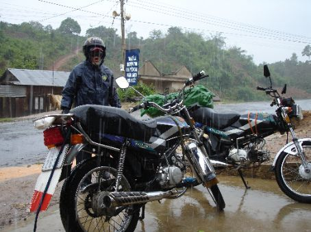 Minh in his wet weather gear and our bikes as we were caught in a down-pour and got really wet. There was thunder and lightning everywhere man and we just kept on riding!