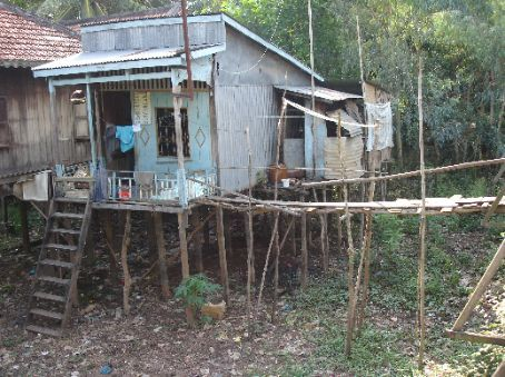 Small house built on stilts to avoid the flood waters.