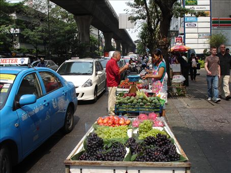 Fruit stalls along the road playing chicken with the busy traffic.