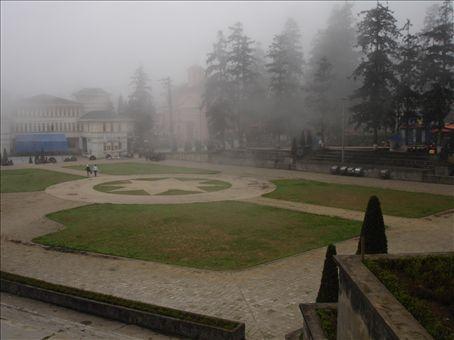 Central Square in Sapa, shrouded in mist.