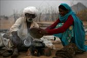 A Trader with his wife cooking dinner in the open field. In the evening you can see all over the trading field make shift 'Choolah' (cooking stove). Some traders come with their wives and few come with their friends but most of them cook their own food.: by thirdeyeview, Views[442]