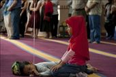 A young muslim girl prays, while her brother lies down, Lakemba Mosque, 9 April 2011. The boy is holding a balloon string.: by timothylorkovic, Views[1969]