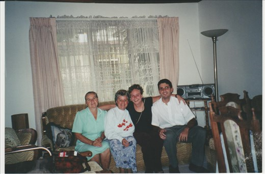 My host family and I.  The town claims my ma is a witch, they say she was praying and the roof blew off of her house.