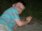 This is in Bonn, outside our apartment - Declan checking out his 'pet' hedgehog.: by tingays-in-europe, Views[349]
