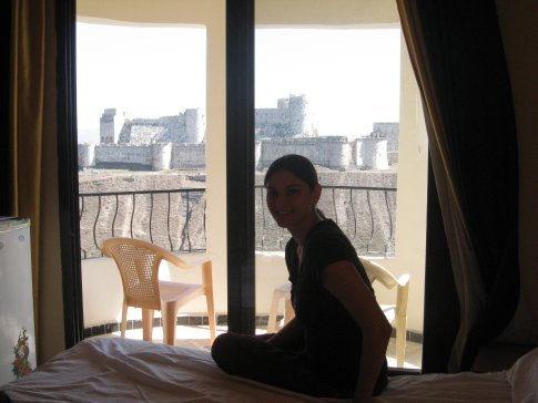 View of Kathryn on our bed with 12th century Crusader Castle in the background